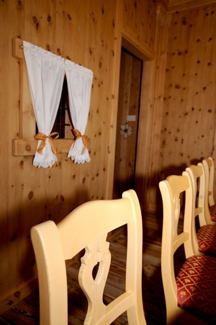 """Private room with total """"cembro"""" pine cladding."""