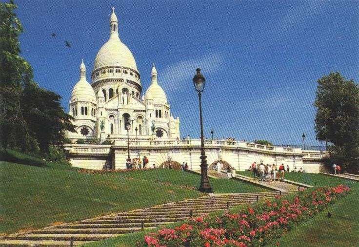 The basilica of Sacre Coeur in Montmartre. Dmitri and Taylor station themselves nearby to paint the view for tourists.