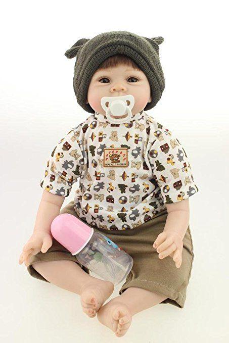 Nicery Morbido Silicone Bambola Reborn Bambino 22inch 55 Centimetri Magnetica Bocca Bella Realistica Sveglia Della Ragazza Del Cappello Nero Giocattolo Baby Doll A3IT