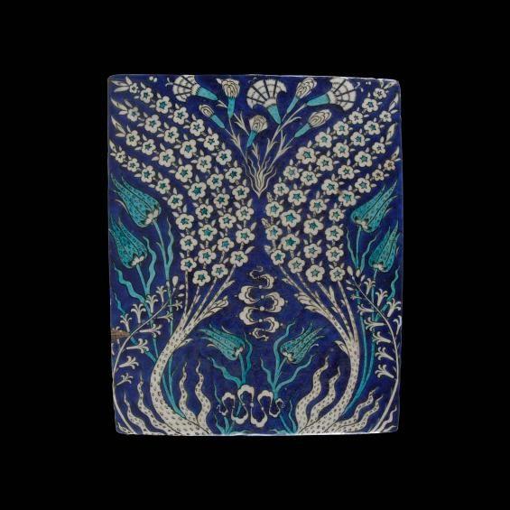 Tile with undulating flowering stems Turkey, c. 1550-60 Stonepaste, underglaze painting over a slip coating W. 37.5 cm; L. 29.5 cm Musée du Louvre, Musée des Arts décoratifs deposit, gift of Jules Maciet, 1903 Ucad 10539