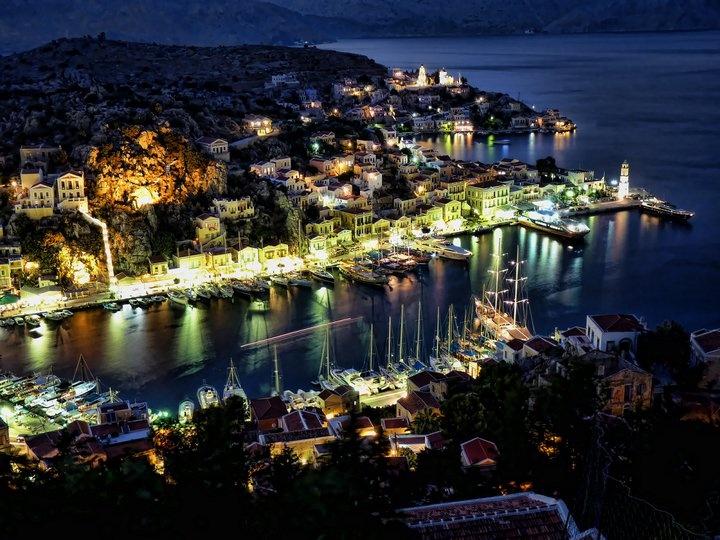 Symi Harbour by night.  Photo by Jordan Blakesley