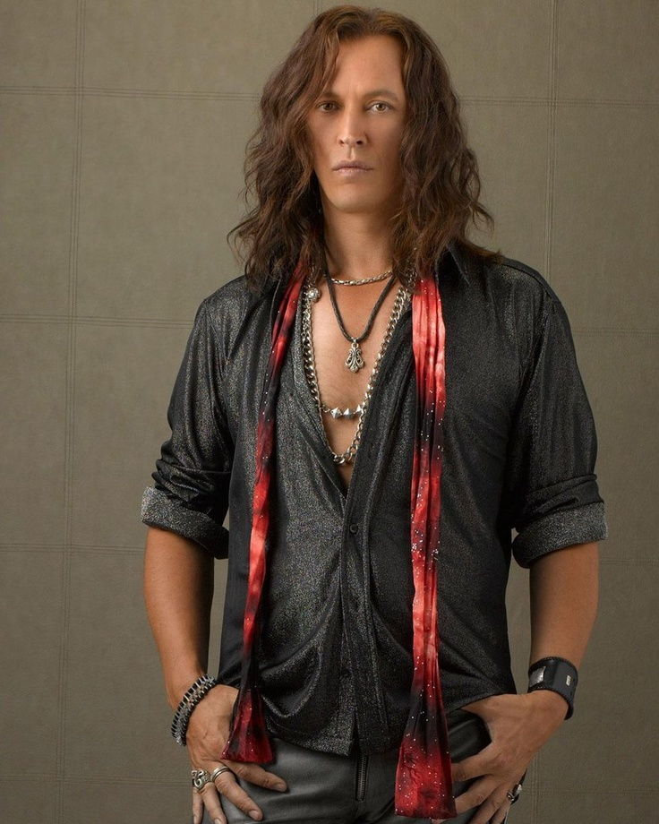 This is Steve Valentine. I'm most familiar with him in Uncharted 2 where he plays my favorite baddy. Again, he's a selective taste. But most of his appeal comes from his acting because when he had jet black slicked back hair from being on Crossing Jordan I didn't dig that AT ALL. But this picture is from when he played a rock band frontman on the Disney XD show I'm In The Band. It's not on anymore sadly, it was the only Disney show I ever enjoyed. But he'll always be Harry Flynn to me.