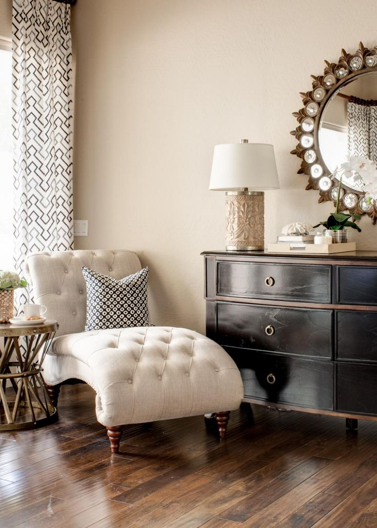 White Tufted Chaise And Black Dresser