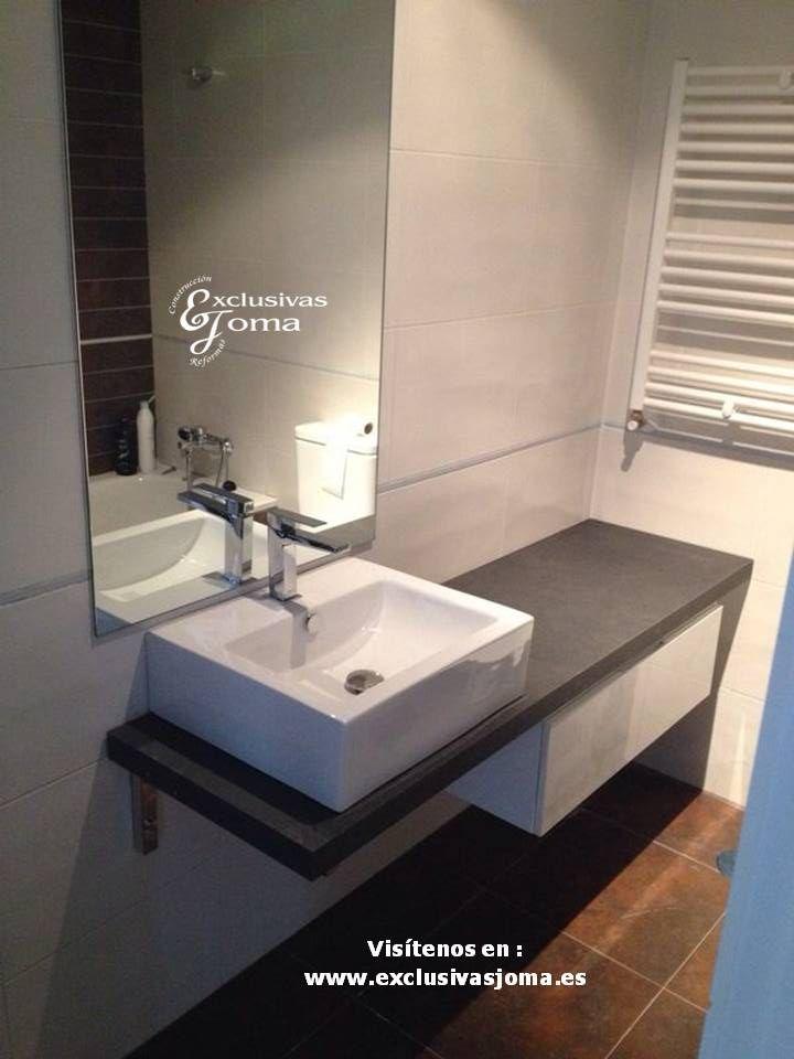 Reforma de ba o realizada con mueble de ba o suspendido for Mueble lavabo sobre encimera