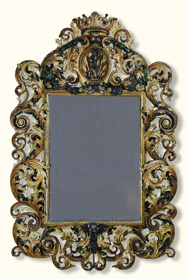 An Austrian Or South German Carved Giltwood And Polychrome Decorated Mirror,  Possibly Innsbruck, Circa