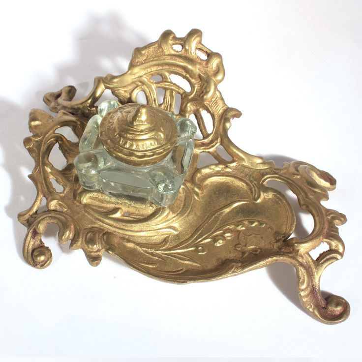 Art Nouveau style brass inkwell stand with glass insert. This is a reproduction of an Art Nouveau era inkwell and stand. It has a beautiful design. Great piece for office decor. The workmanship is not