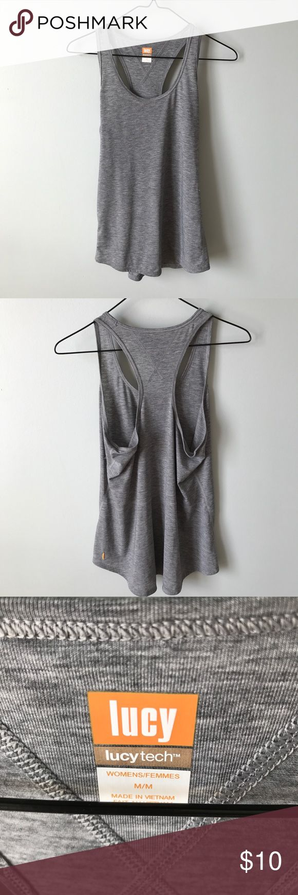 Gray Athletic Top heather gray athletic tank top in perfect condition except for a small cut on the side barely even notice it Lucy Tops Tank Tops