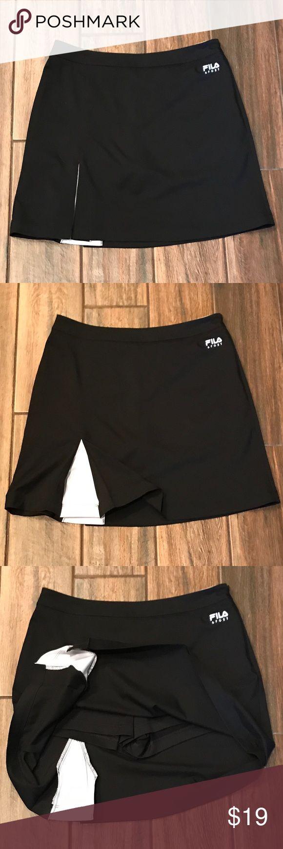 🏌️♀️ LNWOT women's golf skirt; non-smoking home 🏌️♀️NWOT Women's golf skirt, no stains or holes, shorts are under the skirt; non-smoking home Fila Sport Skirts