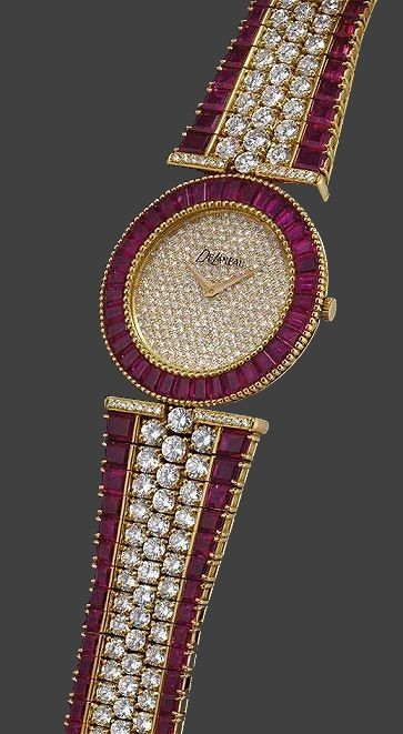 DeLaneau a fine and rare 18K gold, diamond and ruby-set bracelet watch