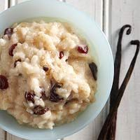 ---SLOWCOOKER: Old-Fashioned Rice Pudding---  4  cups cooked rice  1  12 ounce can evaporated milk  1  cup milk  1/3  cup sugar  1/4  cup water  1  cup raisins, dried cranberries, and/or dried cherries  3  tablespoons butter, softened  1  tablespoon vanilla or vanilla bean paste  1  teaspoon ground cinnamon