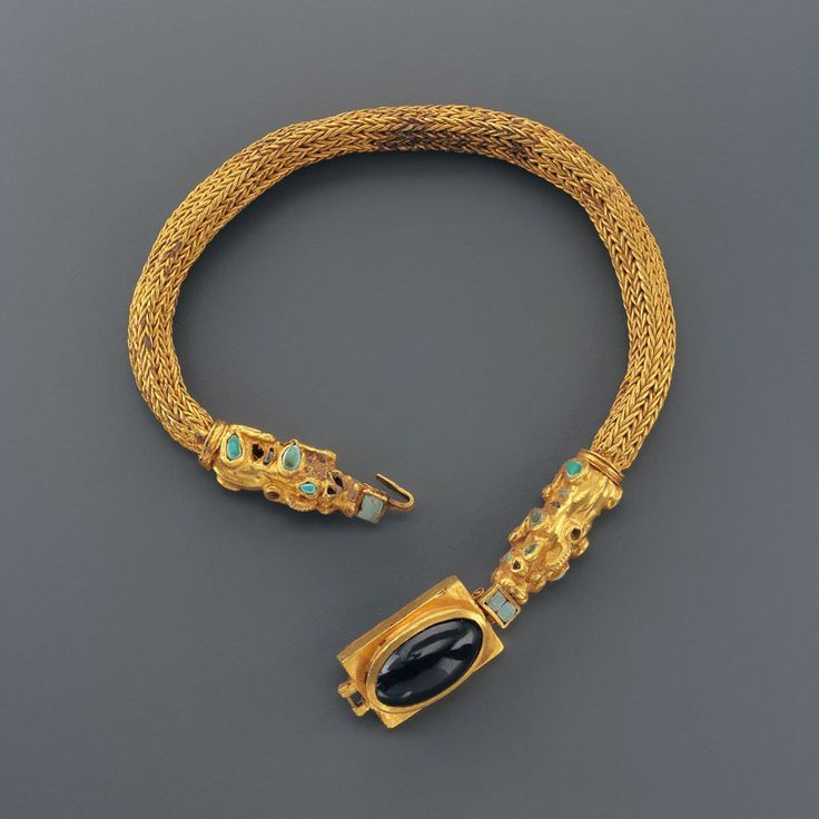 Sarmatian Gold Choker with Mythical Beasts Inlaid with Turqoise and a Large AmethystCabochon Culture : Avar, Sarmatian, Scythian Period : 1st century B.C. - 1st century A.D. Material : Gold, Garnet