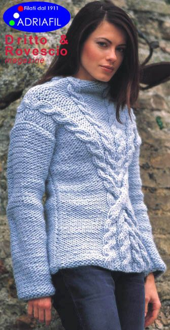 Free knitting pattern for a high necked sweater with criss cross cables in the front, this sweater will keep you super warm with the use of chunky weight yarn.