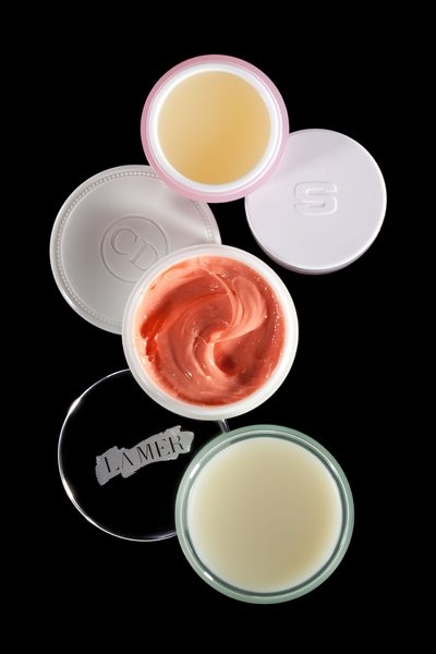 """What feels more indulgent and frivilous than fancy lip balm? These are an easy upgrade for the friend whose beauty routine only includes a swipe of Chapstick before she's late to work.    ----    La Mer """"The Lip Balm,"""" $50; Sisley Confort Extreme Levres Nutritive Lip Balm, $72; Dior Creme Abricot Fortifying Creme, $24"""
