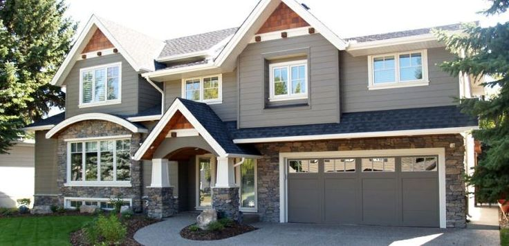 Dark gray house with faux rock and brown accents white trim - Dark grey exterior house paint concept ...