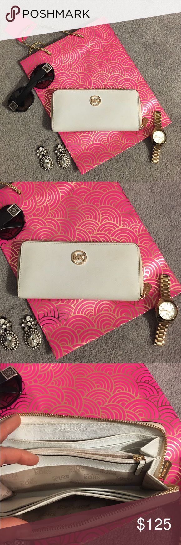 Authentic White leather Michael Kors wallet White Michael Kors wallet. Reasonable offers welcome. Michael Kors watch also up for grabs! Any questions, let me know! Measurements about 8' x 4' inches. Michael Kors Bags Wallets