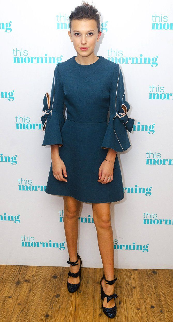 1eaf2f961814 Millie Bobby Brown in a bow-topped blue mini dress
