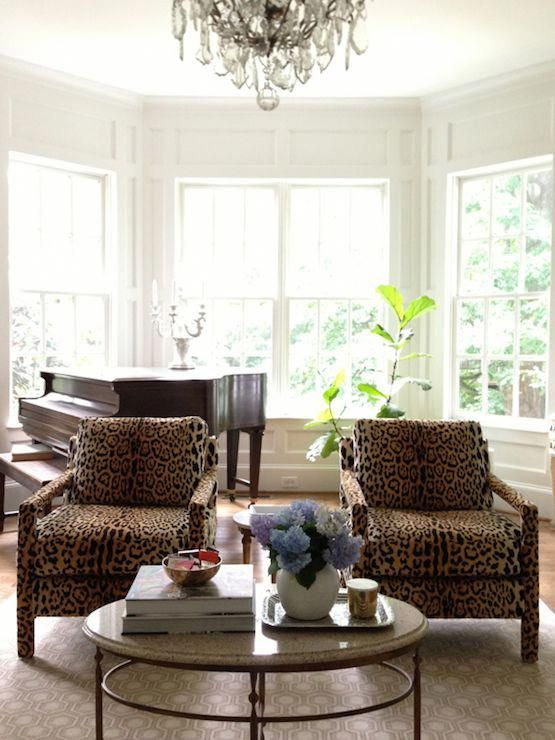 from the right bank living rooms leopard chairs leopard print rh pinterest com