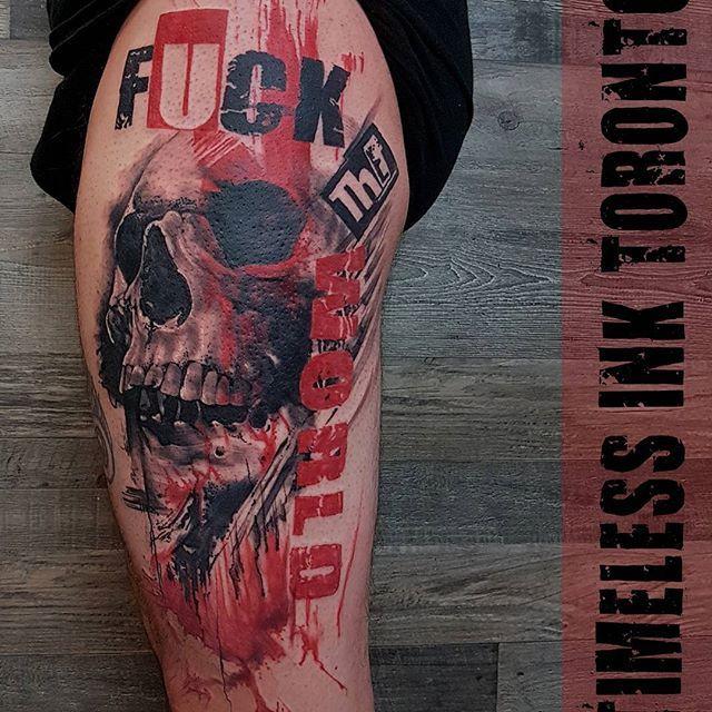 Finished leg  piece... fuck the world . . . . #timelessinktoronto #trashpolkatoronto #blackandred #skulltattoo