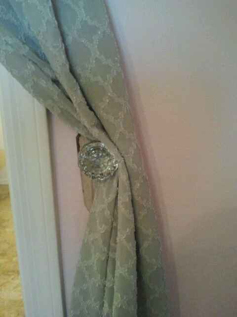 Homemade curtain tieback. Use old doorknobs on each side of window.