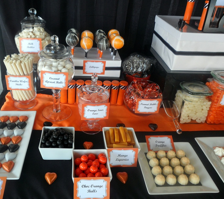 Black and orange lolly buffet styled by Celebrate Sweetly Lolly Buffets, featuring printable buffet tags by Kristy Gray Designs.