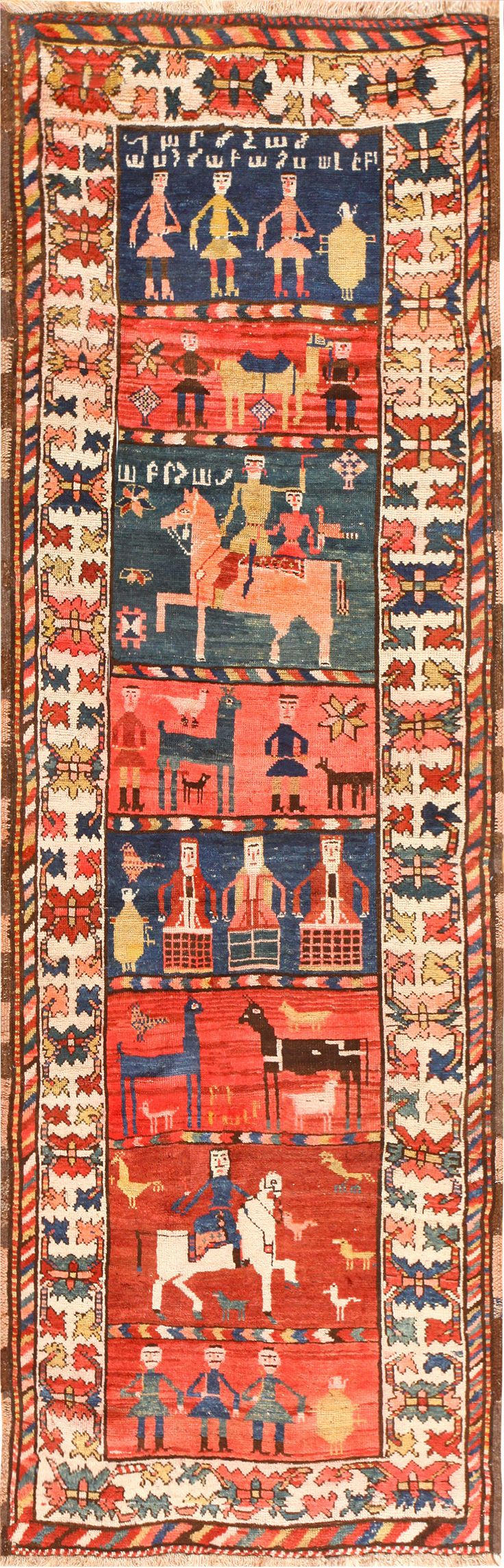 Brilliant Caucasian Karabagh runner, c. 1920. Excellent colours and I love the folk art scenes of daily life, never mind the floral border.