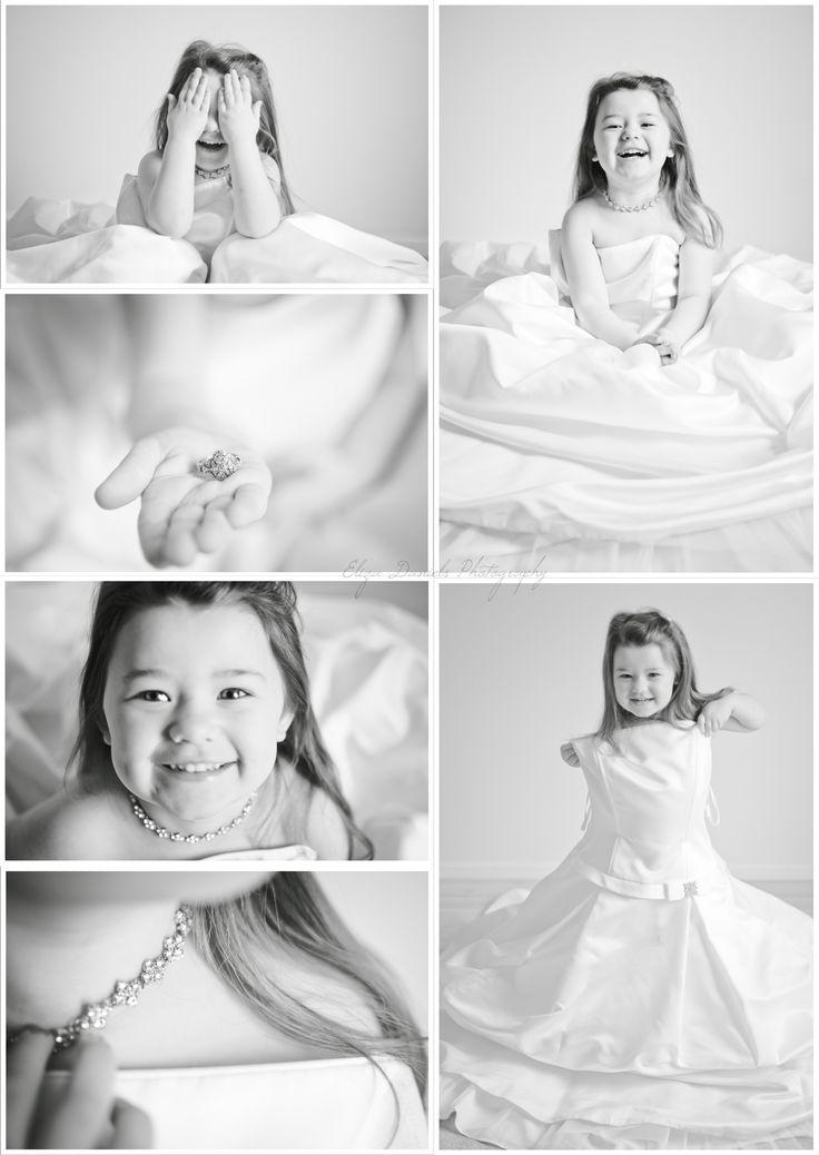 Little girl in her mom's wedding dress.. Love it!