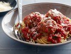 Real Meatballs And Spaghetti - extra virgin olive oil - onion - 2 garlic cloves - fresh parsley - milk - thick slices firm white bread - lean ground beef - ground pork - large egg - grated Parmigiano-Reggiano - kosher salt - 4 cups jarred tomato sauce - mozzarella cheese - fresh basil - spaghetti