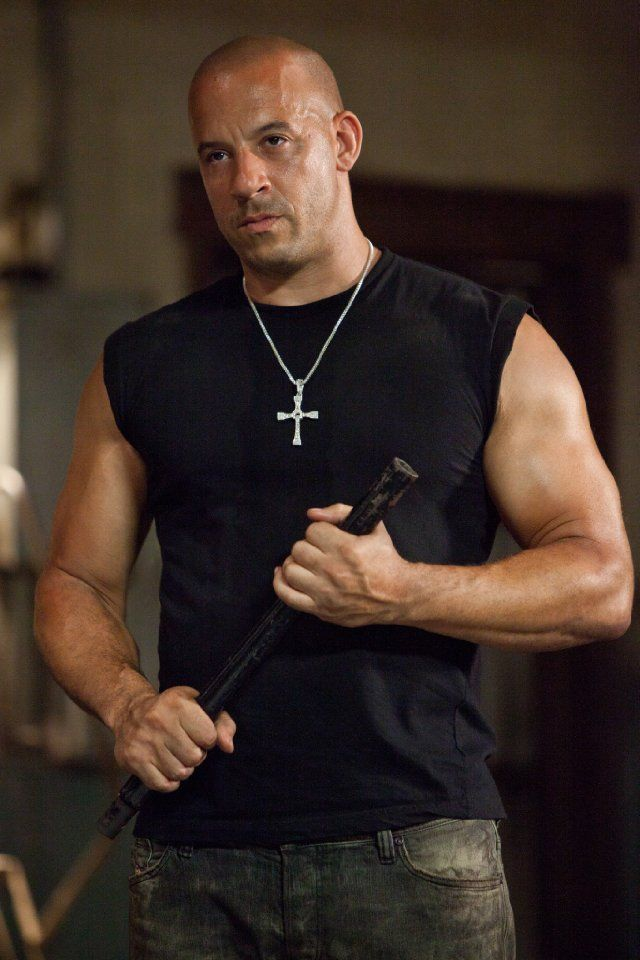 Dom Toretto - The Fast & The Furious. No deep character analysis needed. Look at those arms. Oof!