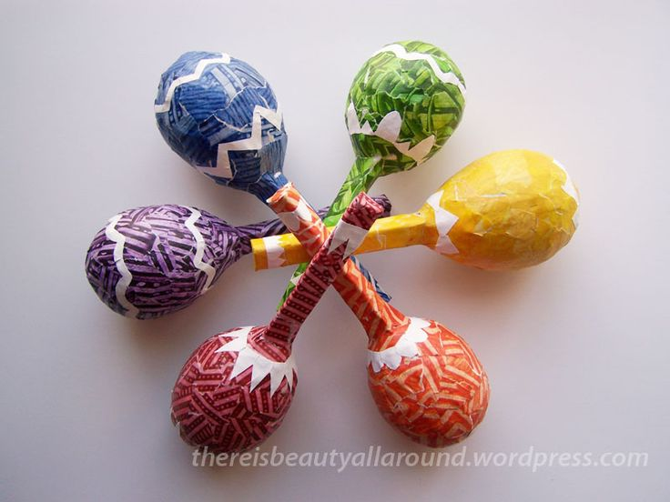 so gorgeous! Paper-mache maracas from balloons.  Not really practical for Summer Reading Program, but love it all the same!