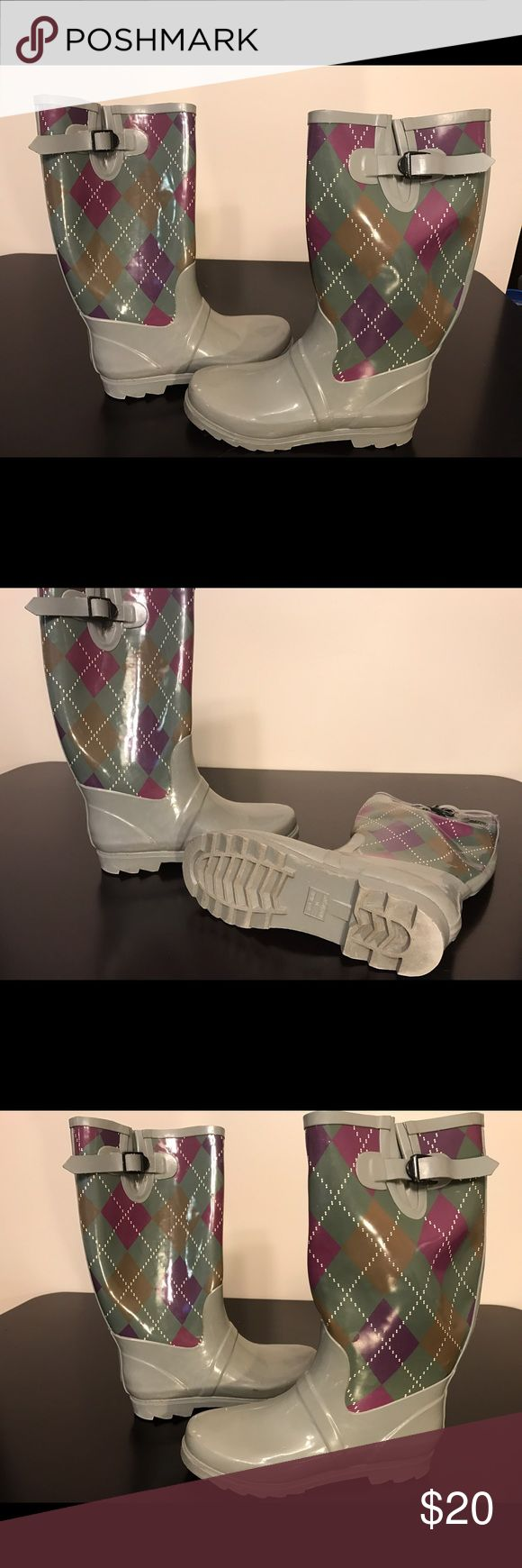 Grey galoshes with pink plaid design Henry Ferrara galoshes. These beauties were worn only a few times when I lived up north for the snow. Now I am down south and never need them. Henry Ferrara Shoes Winter & Rain Boots