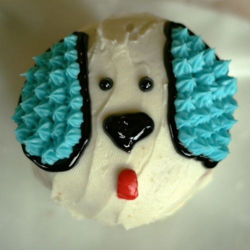 Do with pink frosting and brown ears- puppy cupcake