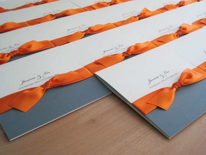 Rhode Island Pocketfold Wedding Invitations in cream and grey and finished with orange ribbon.