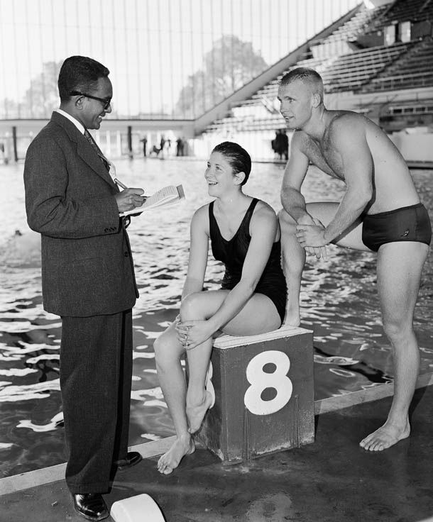 Dawn Fraser and Murray Rose speaking with a member of the press in Melbourne, 1956
