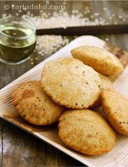 When you want the crispiest of crisp puris, Urad Dal Puri is the best choice! Reinforcing the whole wheat dough with a paste of soaked urad dal adds bulk and crispness to the puris, while the nigella seeds impart a unique and lingering flavour to them. Enjoy these puris fresh and hot, with Dahiwali Aloo ki Subzi.