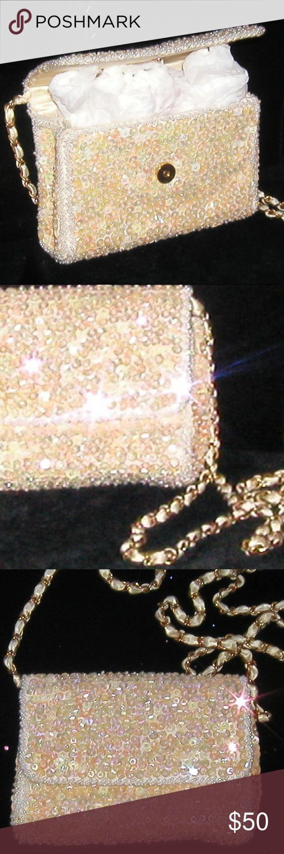 Special Occasion Bag/Purse Iridescence Cocktail 38 Special Occasion Bag/Purse iridescence to reflect the hue of just about any color.  Wearable Artistry... it's the details that makes it stand out from the rest...Evening shoulder or hand envelope Bag/Purse with long shoulder gold & satin twist rope. Fully lined for that Special Occasion when everything must look perfect. Never or barely used floor samples.   Only one of this kind $50.00...sold for $80    Don't wait until it's…