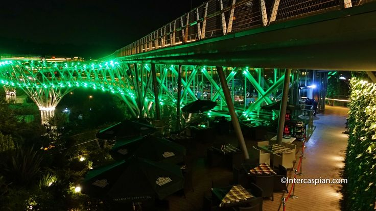 "Tabiat (""nature"") bridge, the largest of its kind in Iran, was architect Leila Araghian's first project. She designed it five years ago while a student, winning a local competition for a plan to connect two parks separated by a highway in north Tehran #tabiatbridge#tehran#iran Night photo of Nature Bridge restaurant entrance"