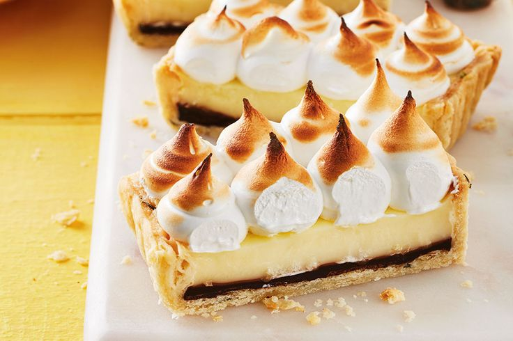 A hidden layer of decadent chocolate and a thyme-infused crust add surprising bursts of flavour to this twist on classic lemon meringue pie.