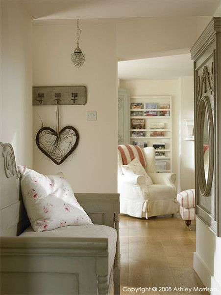 Making an Entrance This beautiful home has more than a touch of Scandi influence - I particularly love how the white chair and splashes of pinky reds work so well with the grey painted bench and mirror. The wide plank solid oak flooring is both practical and adds warmth.
