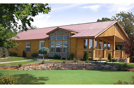 The perfect manufactured home for a cabin in the woods! Large windows in living room, and a beautiful covered porch! www.championhomes.com/manufactured-homes