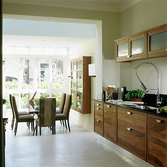 Kitchen With Step Down To Conservatory Dining Area