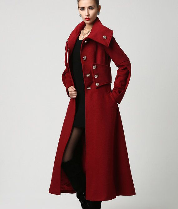 This gorgeous long 70% cashmere coat is highlighted by the oversized standup collar and silver button detailing. When the collar is unbuttoned it falls