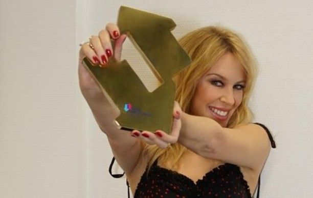 'Golden' is Kylie Minogue's 14th studio album and is also her sixth record to make it to the Number 1 spot in the UK Charts.  The record went straight to Number 1 with 48000 combined sales. 'Golden' even proved to be a huge success compared to the first week sales of her last three albums combined.  Speaking with OfficialCharts.com she said I don't know where to start Thank you to everybody who has been involved in getting Golden to Number 1. I am so overwhelmed happy proud emotion... Get…