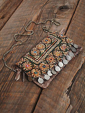 Collective Coin Crossbody | Handmade washed leather crossbody with mirrored vintage tapestry cover and coin dangles. Fuses function with modern bohemian elements to create an embellished staple. Multiple zip compartments for easy organization, and an entire removable zip-off wallet, which can be carried as a clutch.
