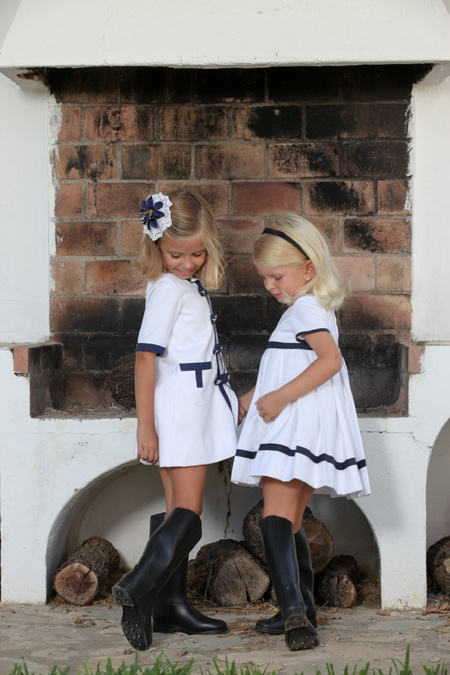 White & navy dresses with long leather boots.