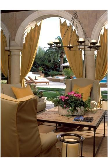 Mark Cutler - Interior Designer - Los Angeles - Eclectic - Traditional - Transitional - Outdoor Room - Rich - Warm - Neutrals - Arches - Columns - Upholstered Chair - Coffee Table - Flowers - Lamps - Candles - Throw Pillows - Woven - Wicker - Curtains - Lounge - Pool - Chandelier - Lights - Palm Tree