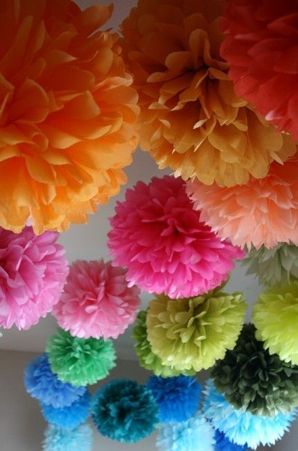 Tissue paper pom poms ~ place them on tables, hang them from a ceiling or tent, or make an archway out of them!  Cheap decorations