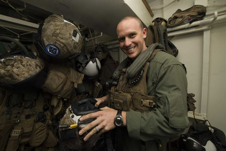 Marine Corps Capt. Benjamin Hovies, a CH-53 Super Stallion helicopter pilot assigned to Marine Medium Tiltrotor Squadron 365 (Reinforced), poses for a photo aboard the amphibious assault ship USS Bataan while at sea in the Atlantic Ocean, March 13, 2017. The ship is deployed with the Bataan Amphibious Ready Group in support of maritime security operations and theater security cooperation efforts in the U.S. 6th Fleet area of responsibility. Navy photo by Petty Officer 2nd Class Magen F. Reed