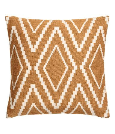 Camel. Cushion cover with a jacquard-weave front and solid-color cotton canvas back. Concealed zip.