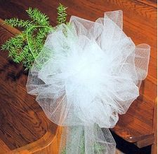 DIY tulle bows...maybe in ivory? From http://www.ehow.com/how_5010378_easily-bows-tulle-minutes-less.html