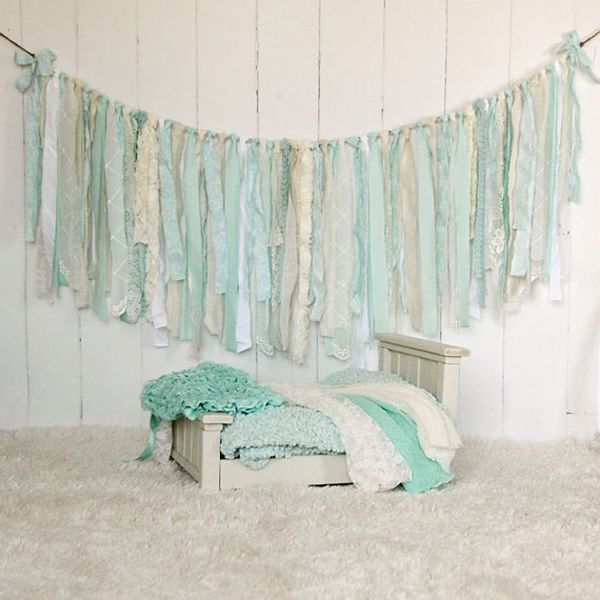 For the perfect shabby-chic look, hang this Burplap, Lace & Linen Rag Tie Banner for a pretty textured backdrop behind your sweetheart table. $33 from EleganceProps
